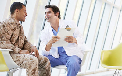 Doctor talking to man in army uniform.