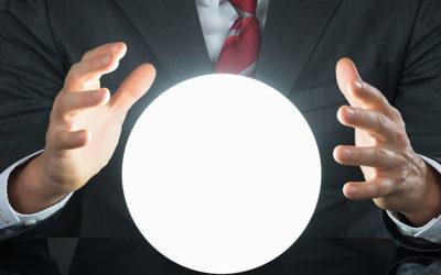 Man's hands around crystal ball