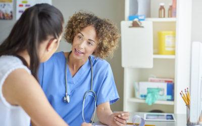 Nurse talking with patient.