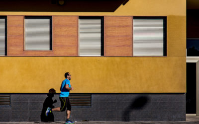 man running by a building